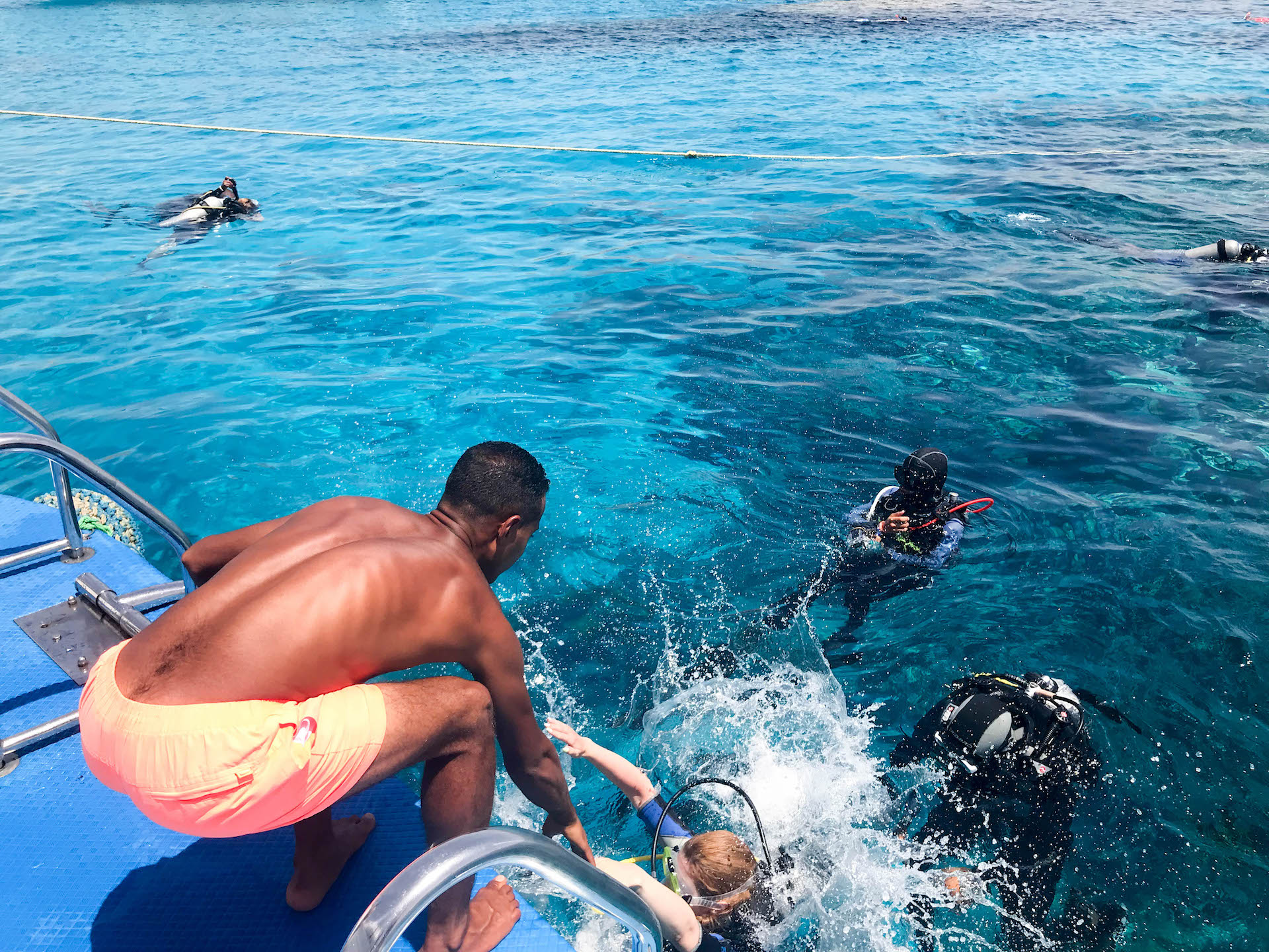 helping spearfisherman back onto boat